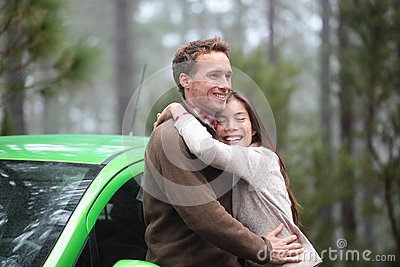 Couple driving in green car in love on travel