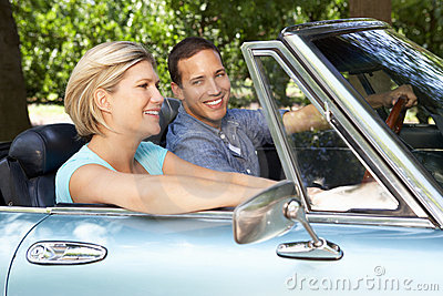Couple driving sports car