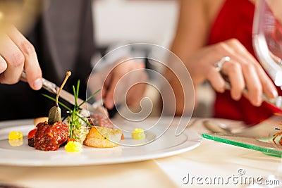 Couple eating dinner in very good restaurant