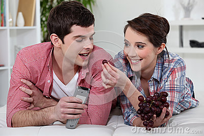 Couple eating grapes