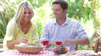 Couple Eating Meal Outdoors stock video footage