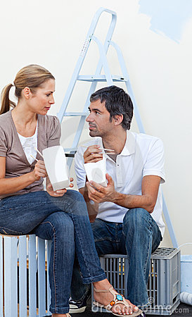 Couple eating while renovating their new house