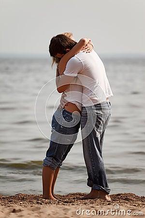 Couple embrace on a beach