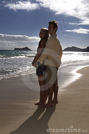 Couple embrace on a tropical beach