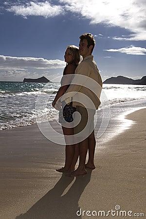 Couple embrace on a tropical beach