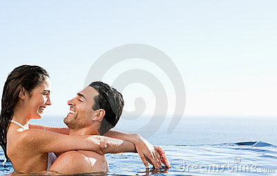 Couple embracing in the pool