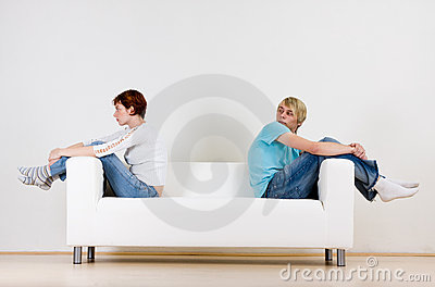 Couple on ends of couch