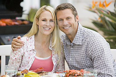 Couple Enjoying A Barbequed Meal