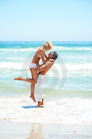 Couple enjoying at the beach during vacation