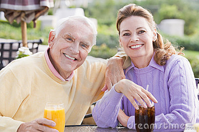 Couple Enjoying A Beverage By A Golf Course