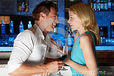 Couple Enjoying Drink In Bar