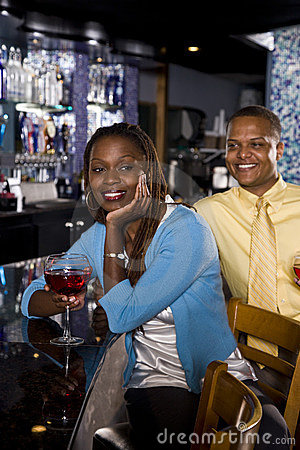Couple enjoying drinks at bar