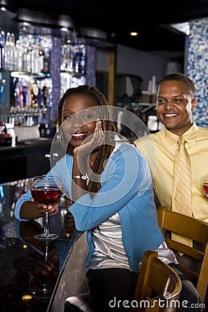 Couple enjoying drinks at bar