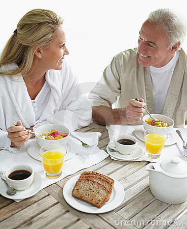 Couple enjoying healthy breakfast at the table