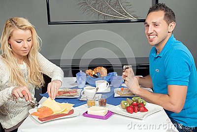 Couple enjoying a hearty breakfast