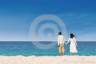 Couple enjoying honeymoon at the beach