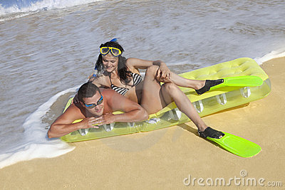 Couple enjoying on an inflatable beach mattress