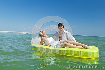 Couple enjoying on an inflatable mattress