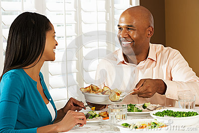 Couple Enjoying Meal At Home