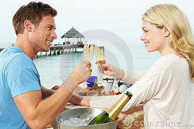 Couple Enjoying Meal In Seafront Restaurant