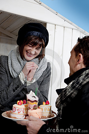 Couple Enjoying Pastry Outdoors