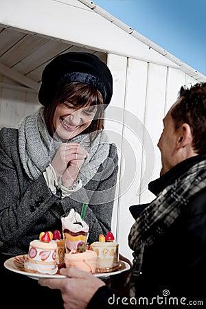 Couple Enjoying Pastry Outdoors