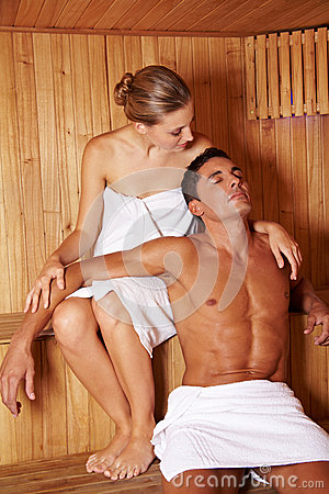 Couple enjoying sauna together