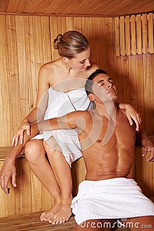 Couple enjoying sauna together
