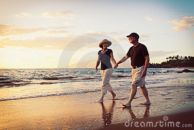 Couple Enjoying Sunset at the Beach