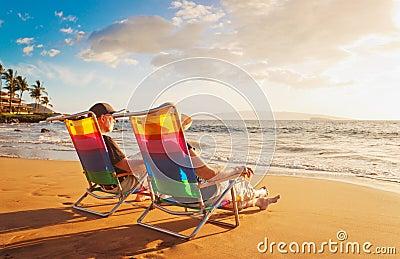 Couple Enjoying Sunset at the Beach