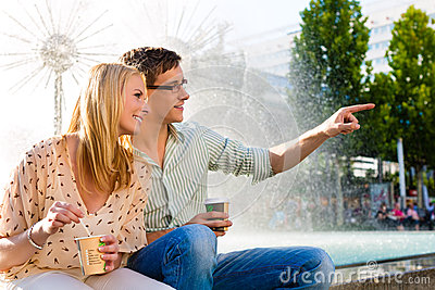 Couple enjoying take away coffee in a break
