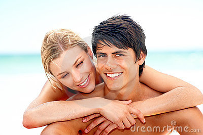 Couple enjoying their vacation on beach