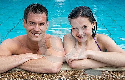 Couple enjoying themselves at public swimming pool