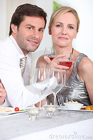 Couple enjoying wine with dinner