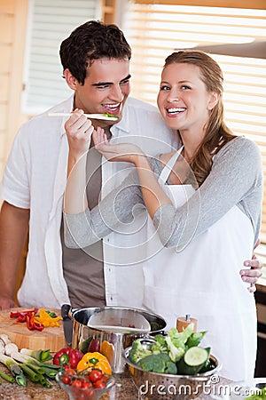 Couple enjoys preparing dinner together