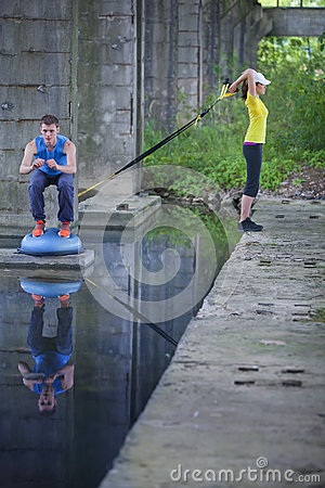 Professional sporty man and woman outdoor training