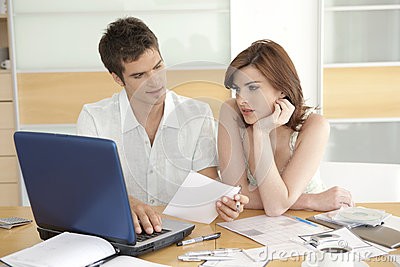 Couple Finances in Kitchen