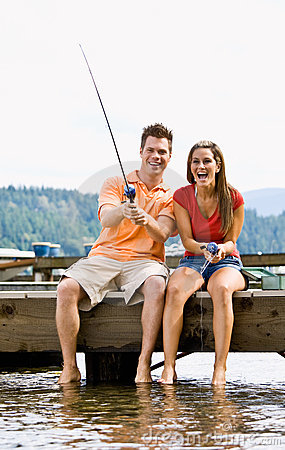 Free Couple Fishing On Pier Stock Photos - 7379233