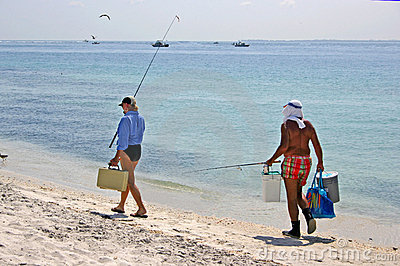 Couple fishing by sea