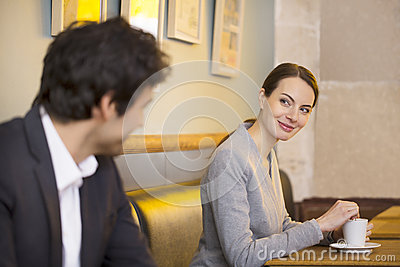 Couple Flirting Together In Bar