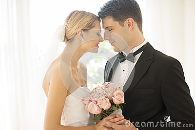 Couple With Flower Bouquet Rubbing Noses