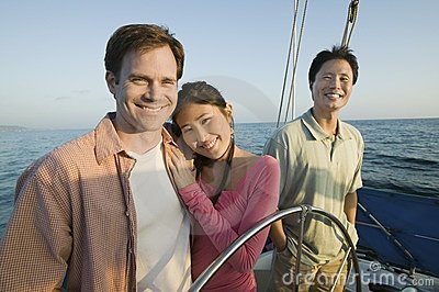 Couple with friend on yacht