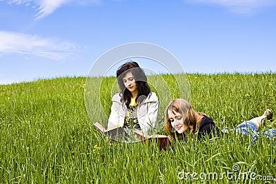 Couple of friends enjoying a book