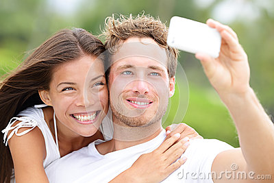 Couple fun taking self-portrait picture photos