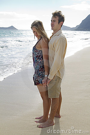 A couple gaze into the ocean in Hawaii