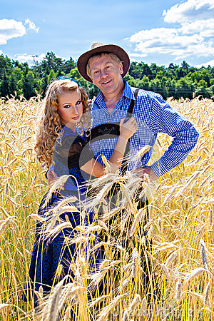 Couple in german tracht on the field
