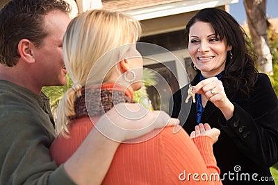 Couple Get House Keys from Hispanic Agent