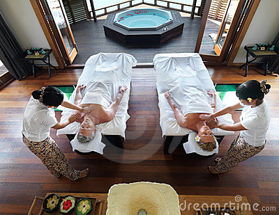 Couple getting a massage at spa resort