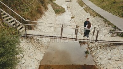 Couple goes over the bridge. A couple goes over the bridge, a view from above stock footage