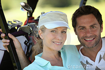 Couple in golf sportswear